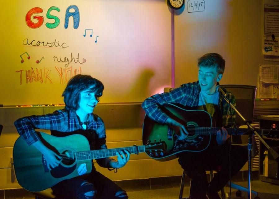 """Tuning up-- Seniors Angelica Padua and Dexter Willett play guitars at GSA's annual Acoustic Night. The duo played a song entitled """"Bulletproof Love"""" by Pierce the Veil."""