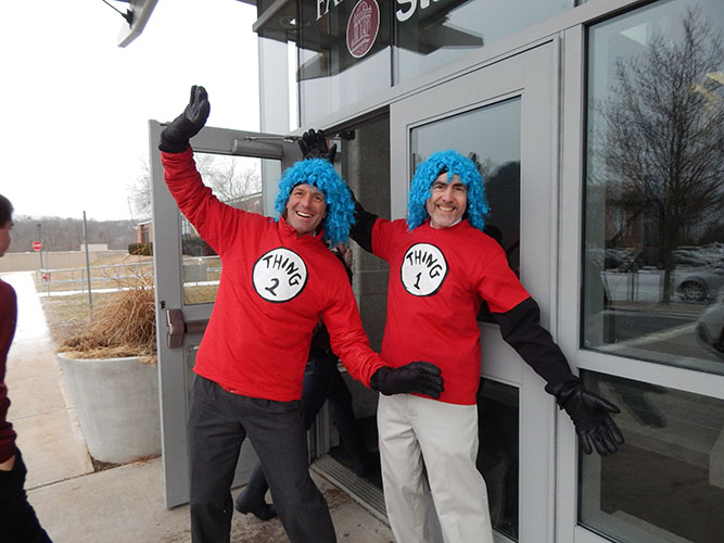 Seeing  double-- Assistant Principal Curt Pandiscio (left) and Principal Bill Silva (right) greet students in the morning in Thing 1 and Thing 2 attire.