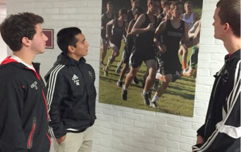 Seniors Jared Edelson, Luis Encinas and Jeff Fisher observe the new pictures hanging in the hallways.