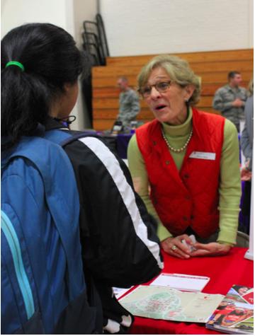Senior Niki Patel speaks to a representative from Stony Brook University during the October 21 college fair.