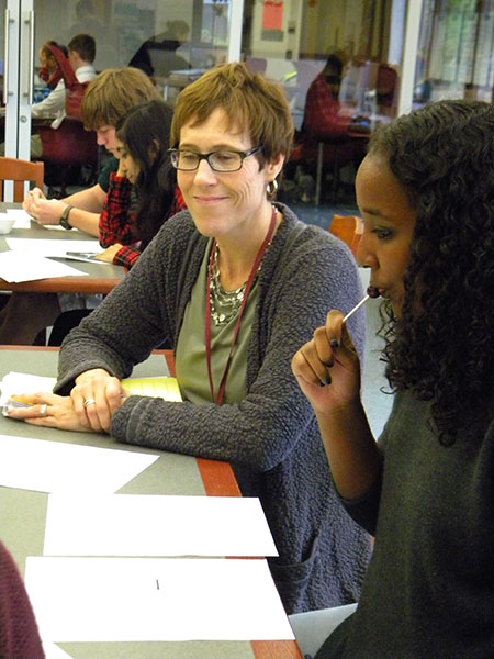English teacher Tracey Barlow collaborates with sophomore Safaa Buuh on her writing.