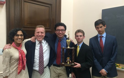 Buzzing in--(Left to right) Senior Nimrita Singh, team coach and economics teacher Joel Nick, junior Allen Haugh and seniors Anthony DiPaulo and Alex Wuschner are presented with the second place trophy in the Harvard Pre-collegiate Economics Challenge (HPEC). The team lost to the Harker School, 45 to 40 in the final round.