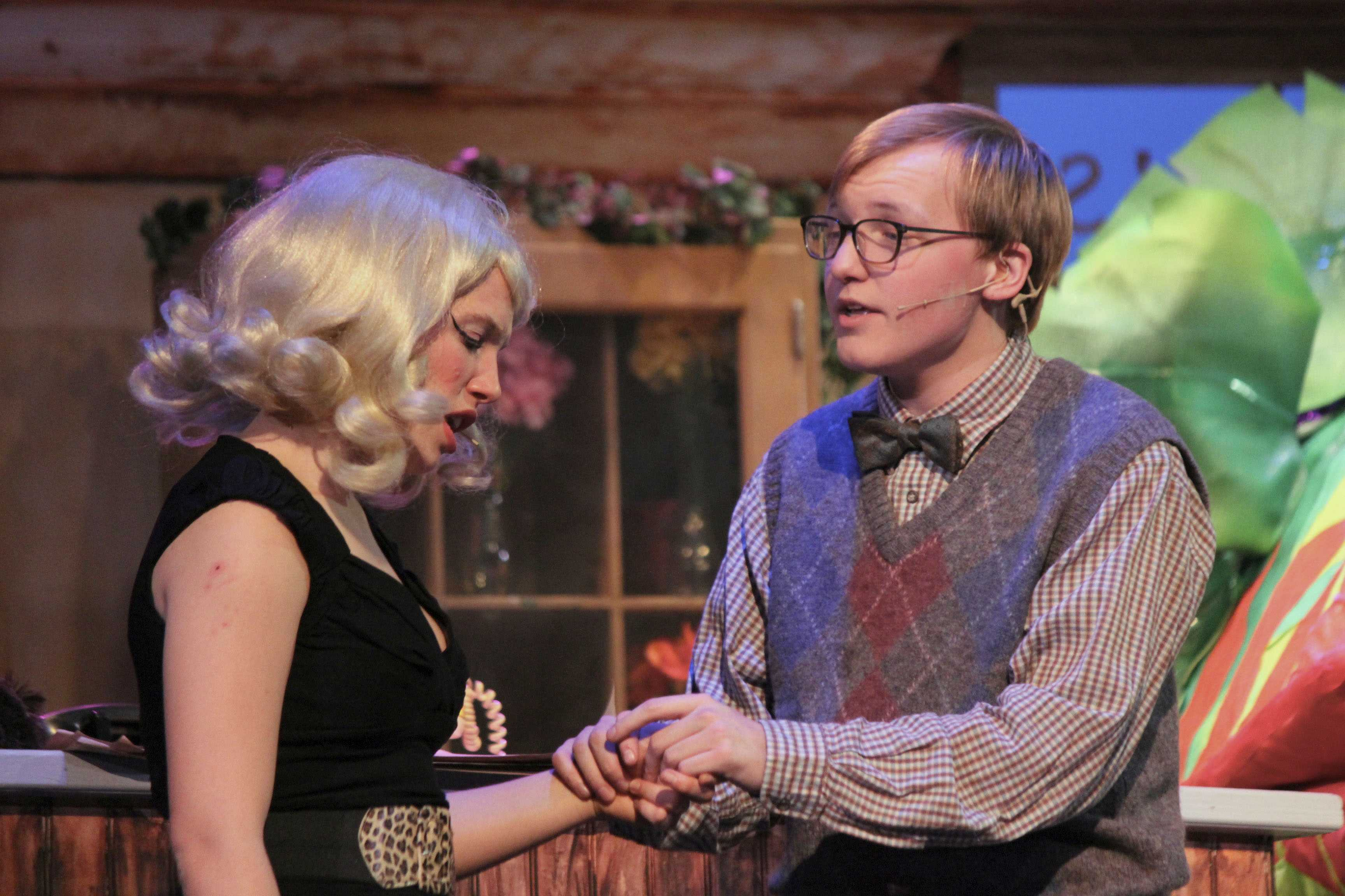 """Suddenly smitten-- Senior Jonathan Hammond (Seymour) and senior Emily Williams (Audrey) confess their love for one another during the song """"Suddenly Seymour"""" during the Friday showing of Little Shop of Horrors. The cast and crew did three performance between March 3, 4 and 5."""