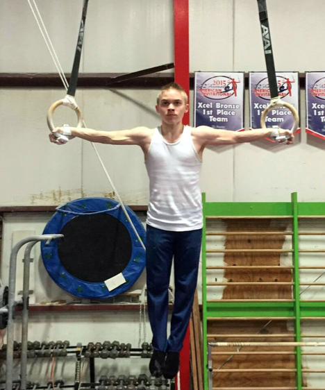 Going for gold -- Swanson practices on the rings at The American Gymnastics Training Center in Southington, Conn on April 1. He looks to focus on this event next year.