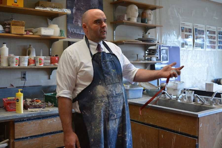 Fire and glaze-- Art teacher Andrew Minor goes over the parameters of the current ceramics project for the Ceramics class. Minor has been teaching at the high school for the past eight years and is the first art teacher to ever be nominated as the graduation speaker.