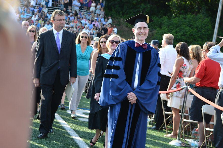 Principal+Bill+Silva%2C+Superintendent+Kathy+Greider+and+Chairman+of+the+Board+of+Education+lead+the+procession.+Senior+students+graduated+on+June+20+at+6+p.m.+on+the+turf+field.