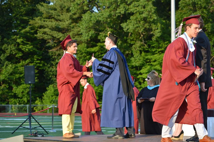 2016+graduate+Anthony+Arguelles+receives+his+diploma.