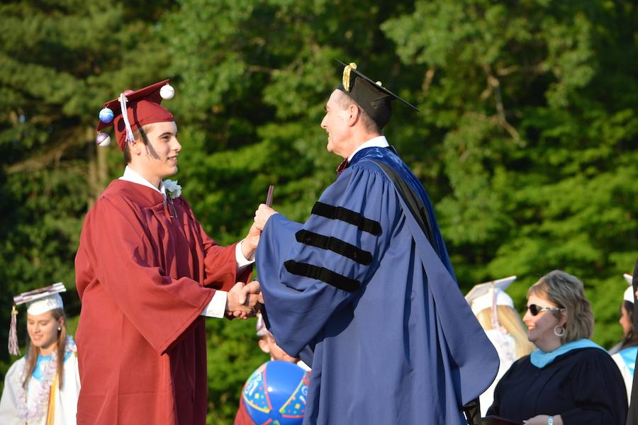 2016+graduate+Isaac+Baker+receives+his+diploma.