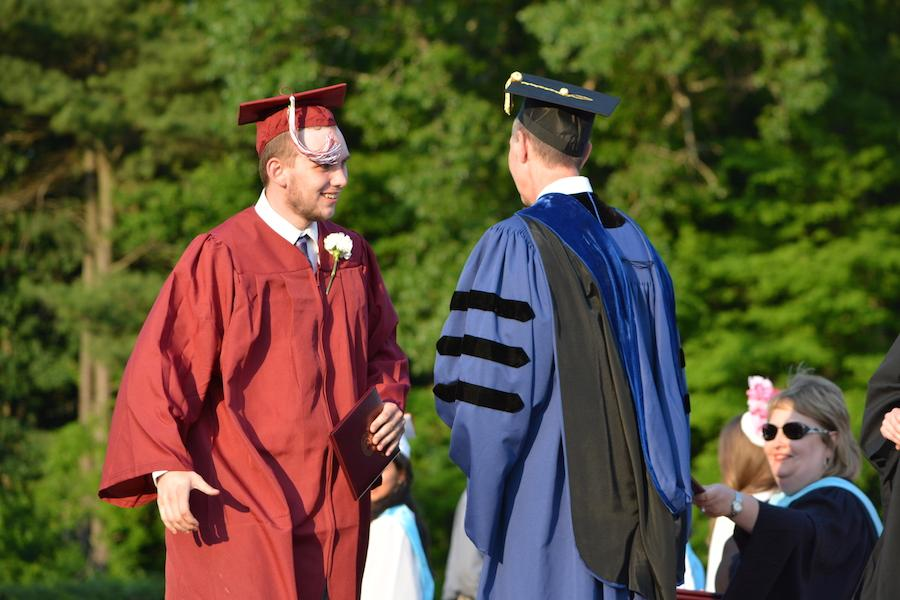 2016+graduate+Hunter+Beecher+receives+his+diploma.