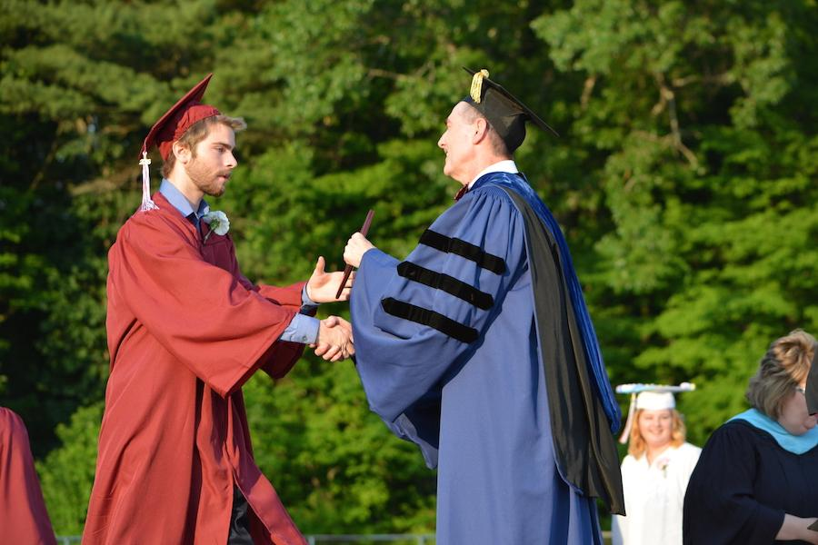 2016+graduate+Chris+Boains+receives+his+diploma.