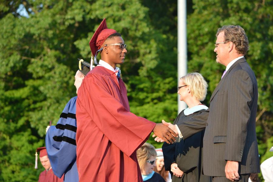 2016+graduate+Neville+Buxton+receives+his+diploma.