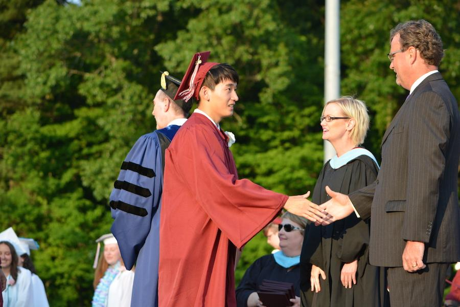2016+graduate+Mike+Chang+receives+his+diploma.