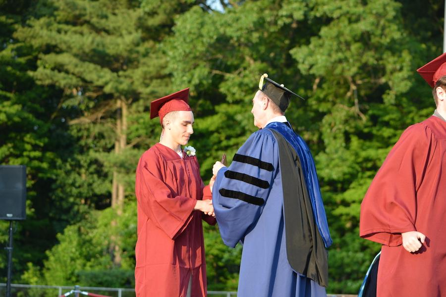2016+graduate+Casey+Curtis+receives+his+diploma.