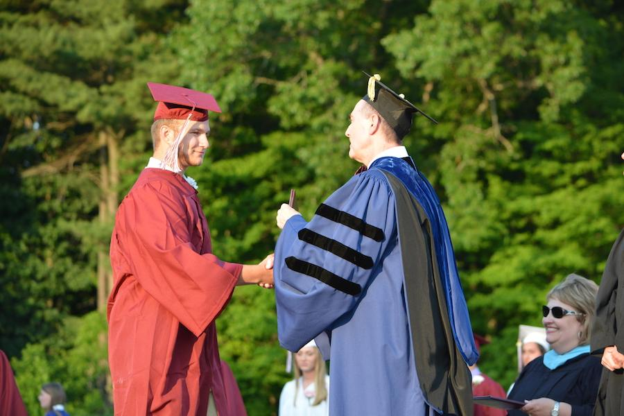 2016+graduate+Dan+Douglas+receives+his+diploma.