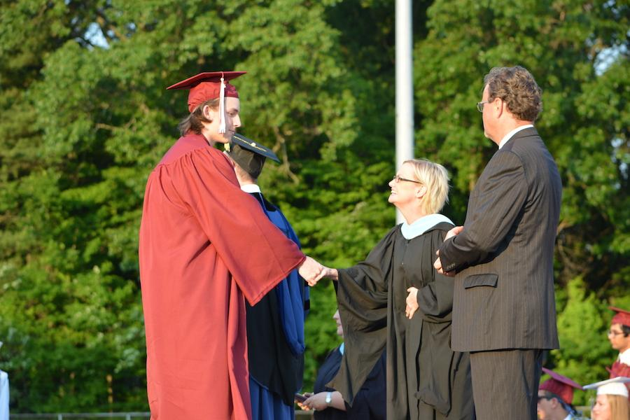 2016+graduate+Carson+Frey+receives+his+diploma.