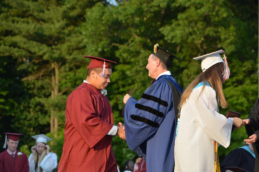 2016+graduate+Joe+Holland+receives+his+diploma.