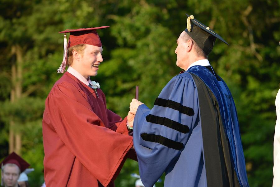 2016+graduate+Evan+Hughes+receives+his+diploma.
