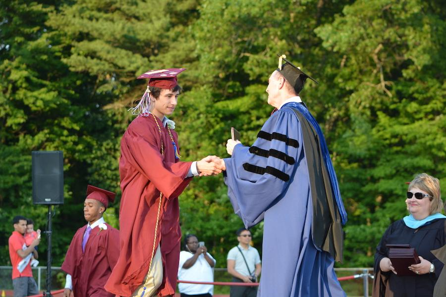 2016+graduate+Stefan+Izydorczak+receives+his+diploma.