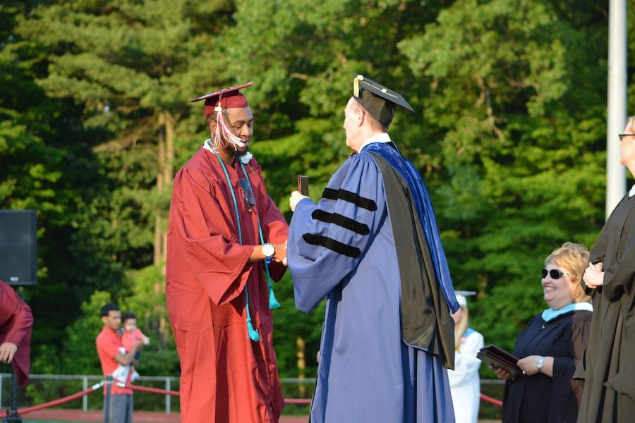 2016+graduate+Kalen+Jones+receives+his+diploma.