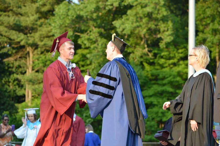 2016+graduate+Christian+Knight+receives+his+diploma.