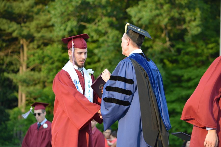 2016+graduate+Matthew+McLeod+receives+his+diploma.