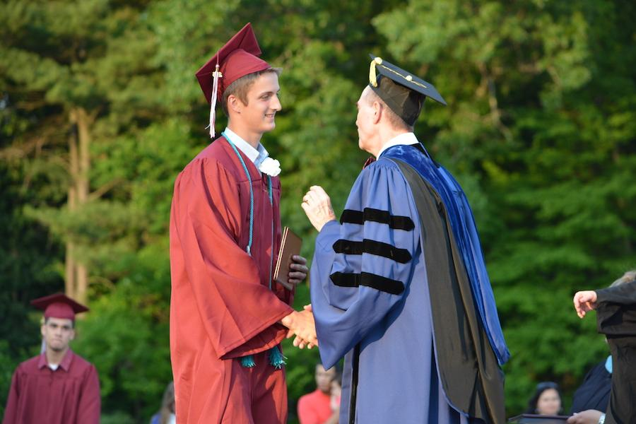 2016+graduate+Joe+McNamara+receives+his+diploma.