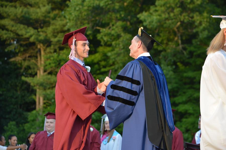 2016+graduate+Devlin+Moody+receives+his+diploma.