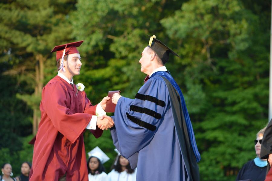 2016+graduate+Dylan+Papaleo+receives+his+diploma.