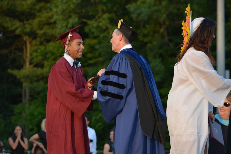 2016+graduate+Marcos+Rodriguez+receives+his+diploma.
