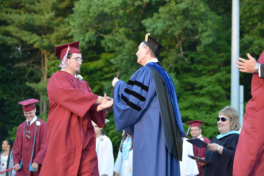 2016+graduate+Tim+Roy+receives+his+diploma.