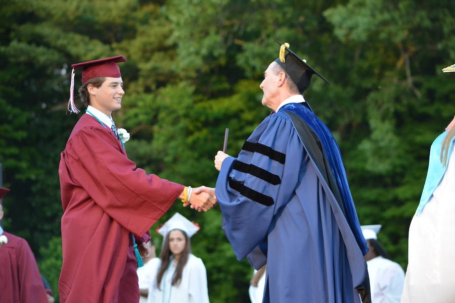2016+graduate+Trey+Stepeck+receives+his+diploma.