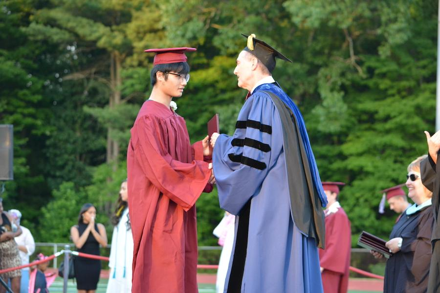 2016+graduate+Jia+Wang+receives+his+diploma.