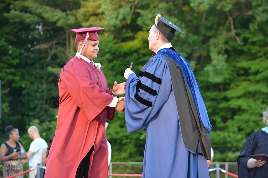 2016+graduate+Miguel+Zayas+receives+his+diploma.