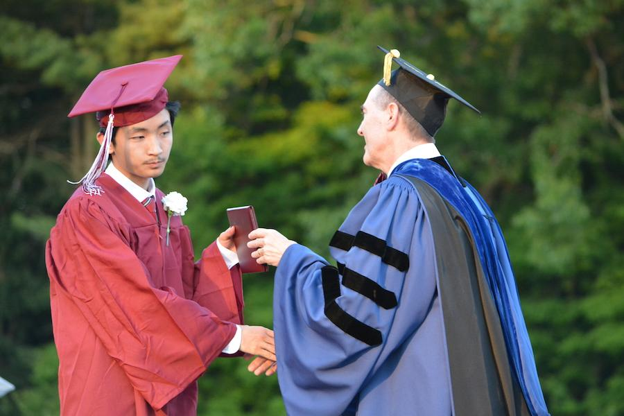 2016+graduate+Frederick+Zhang+receives+his+diploma.