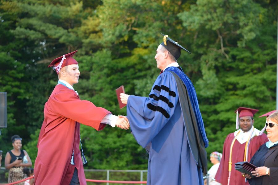 2016+graduate+Ryan+Dopp+receives+his+diploma.
