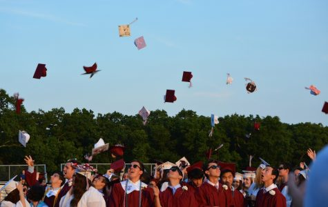 The Class of 2016 celebrates their graduation with the traditional the cap toss.