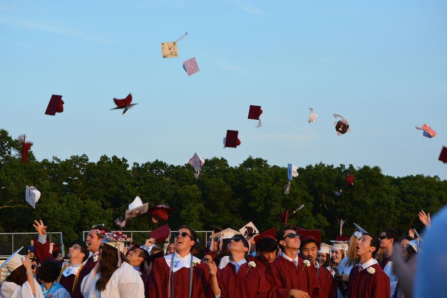 The+Class+of+2016+celebrates+their+graduation+with+the+traditional+the+cap+toss.