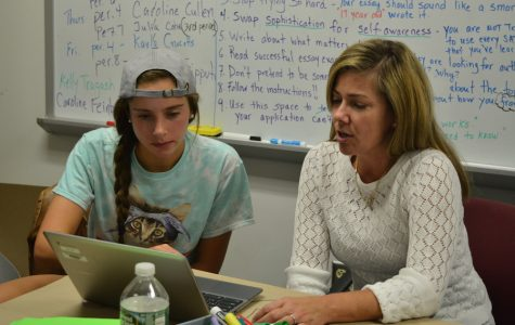 College-bound-- Senior Caroline Feinberg works with writing tutor Cindy Moeller on her college essay. Students are finishing their essays for the November 1 deadline.