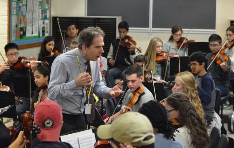 Professional director visits with music students