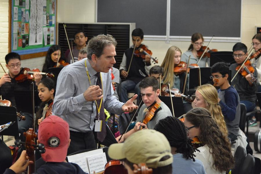 "Playing a tune-- Director of the Hartt School of Music orchestras Edward Cumming leads students in ""Symphony Number 8 in G Major"" by Antonin Dvorak. Cumming was recently hosted as a guest speaker in the Music Department on October 24 to speak to the String Ensemble students about careers in music."