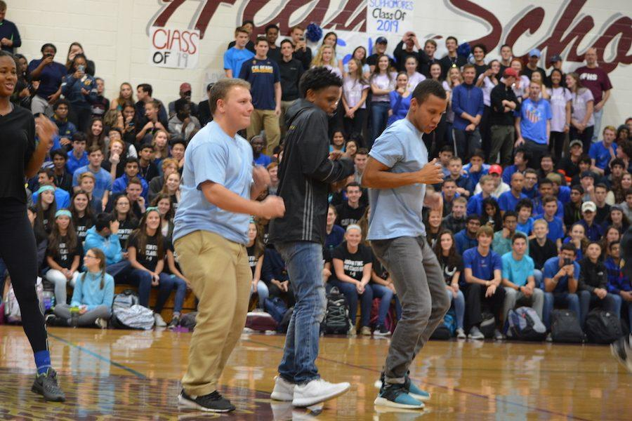 Show+me+your+moves--+Seniors+Jake+Rappaport+%28left%29+and+Ian+Thomas+%28right%29+and+sophomore+Shamir+Holt+%28center%29+show+their+moves+in+Dance-off.+The+pep+rally+took+place+on+November+4+in+the+new+gym.