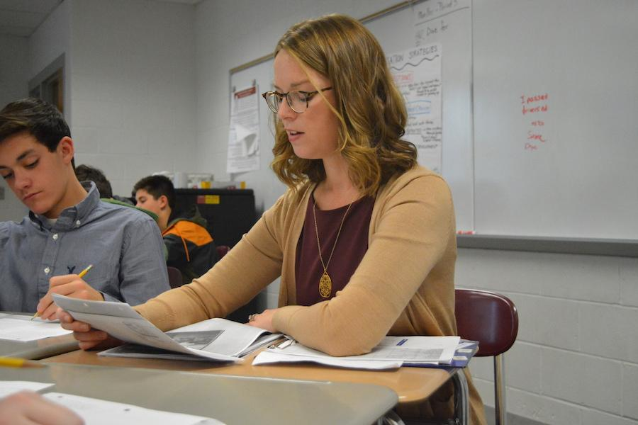 Working together-- Freshman Jake Brickner works with English Department Leader Amy Miller during a read aloud speed-dating exercise. Miller began working at the high school on October 31.
