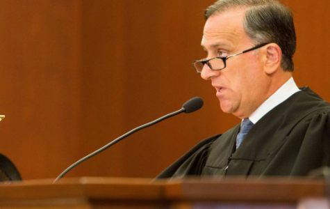 Justice speaks-- Judge Thomas Moukawsher presents his decision in Connecticut Coalition for Justice in Education Funding v. Rell. Moukawsher's decision to read his entire decision from the bench was an unusual one that drew further attention to the case.