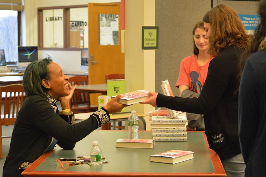 Autograph+please%3F--+Young+adult+author+Nicola+Yoon+signs+her+book+for+junior+Rita+Monahan+at+her+recent+visit+to+the+high+school+on+December+1.+Yoon+came+to+discuss+her+newest+novel%2C+The+Sun+is+Also+a+Star.+
