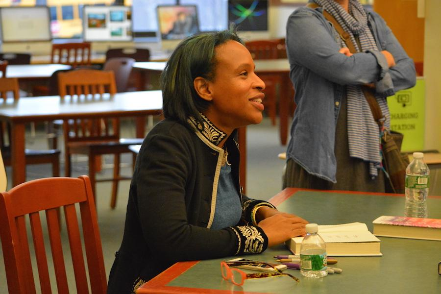 Autograph+please%3F--+Young+adult+author+Nicola+Yoon+signs+books+for+students%2C+faculty+and+staff+at+her+recent+visit+to+the+high+school+on+December+1.+Yoon+came+to+discuss+her+newest+novel%2C+The+Sun+is+Also+a+Star.+