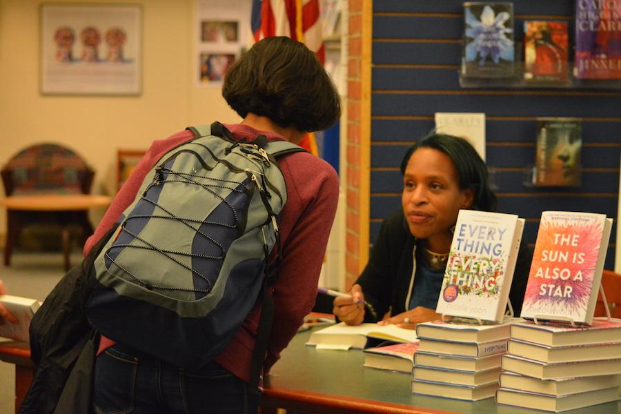 Autograph+please%3F--+Young+adult+author+Nicola+Yoon+signs+her+book+for+freshman+Sia+Goel+at+her+recent+visit+to+the+high+school+on+December+1.+Yoon+came+to+discuss+her+newest+novel%2C+The+Sun+is+Also+a+Star.+
