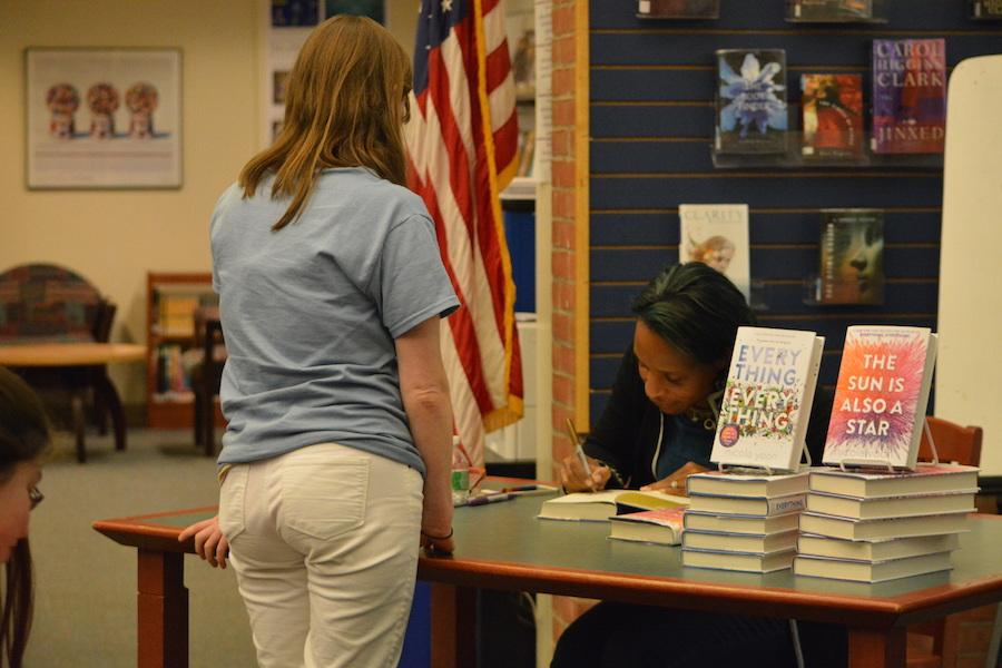 Autograph+please%3F--+Young+adult+author+Nicola+Yoon+signs+her+book+for+English+teacher+Katie+Buckley+at+her+recent+visit+to+the+high+school+on+December+1.+Yoon+came+to+discuss+her+newest+novel%2C+The+Sun+is+Also+a+Star.+