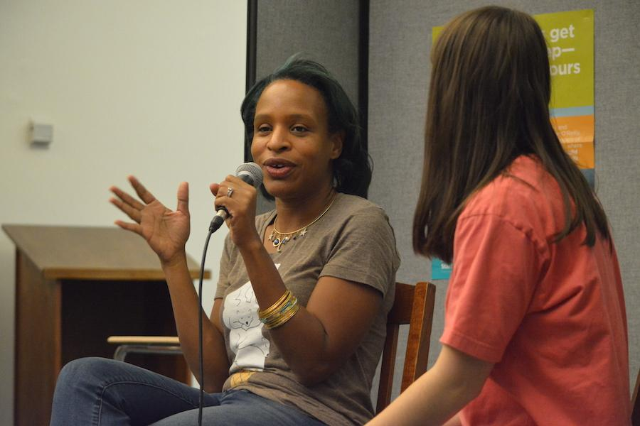 Bonding+over+books--+Young+adult+author+Nicola+Yoon+answers+questions+by+senior+Alex+Appel+and+audience+members+at+her+recent+visit+to+the+high+school+on+December+1.+Yoon+discussed+her+newest+novel%2C+The+Sun+is+Also+a+Star%2C+a+story+about+a+two+dissimilar+teens+who+fall+in+love+in+12+hours.