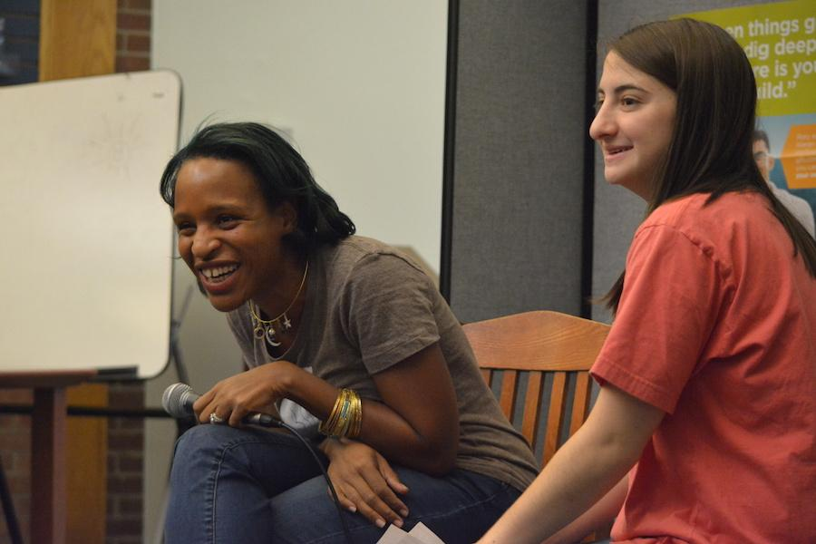 Bonding over books-- Young adult author Nicola Yoon answers questions by senior Alex Appel and audience members at her recent visit to the high school on December 1. Yoon discussed her newest novel, The Sun is Also a Star, a story about a two dissimilar teens who fall in love in 12 hours.