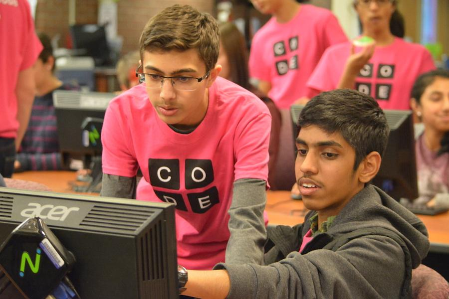 Cracking the code-- Junior Rohan Parikh and sophomore Dhatchinamoorthi Kunde Govindarajan work together on basic  programming at the annual Hour of Code. Hour of Code took place on December 7 after school in the library and during the school day on December 9.